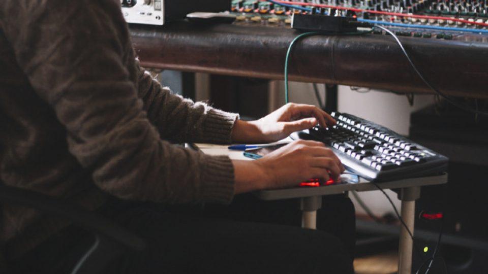 crop-sound-engineer-working-at-studio_23-2147769055[1]
